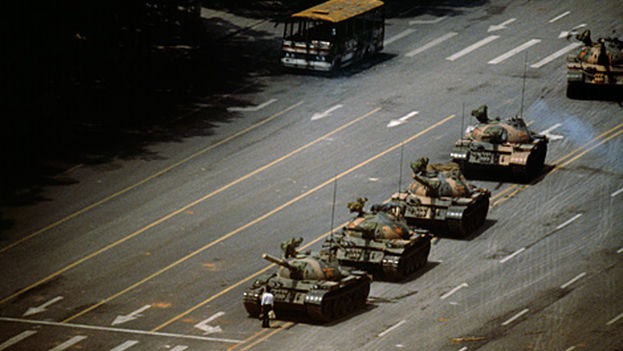 The Tank Man became internationally known, caught standing before a column of tanks in the Tiananmen revolt (1989)