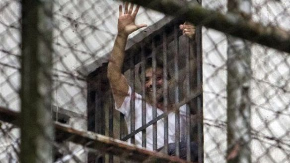 Leopoldo Lopez waves from a window of the Ramo Verde military prison in Caracas. (EFE)
