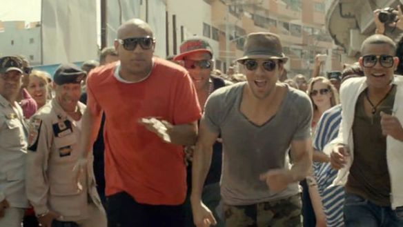 "Enrique Iglesias in a file image with the Cuban group ""Gente de Zona"". (Networks)"